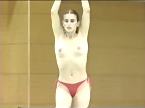 Former pro-gymnast from Romania doing her routine topless