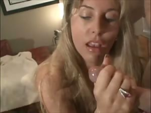 Wifey sucks Hubby`s cock and then licks all of the cum off of a glass table