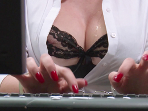 Secretary Gigi Allens is drilled across her desk