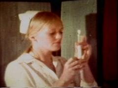 Cock sucking nasty nurse gets fucked in vintage porn scene