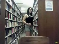 Sweet brunette with big tits flashing tits and pussy at a public library