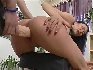 Ninel is bent over and fucked with a huge strapon dildo
