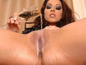 Mega Pornstar Pours Some Bubbly And Stuffs Her Snatch