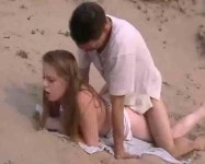 Cute couple having sex on the beach