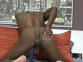 Ebony boy jerking his hard dick