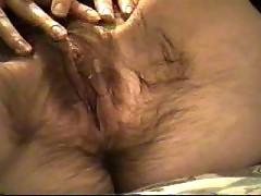 Wife masturbates hairy pussy.