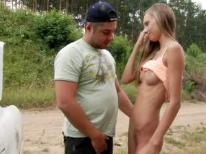 Tanned blonde girl strips before strange guy in the street