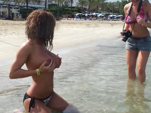 Two sensational girls topless at the beach