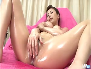 Big titty Yuki Aida is oiled up at the hospital and left to her own devices she begins to fondle her tits and pussy