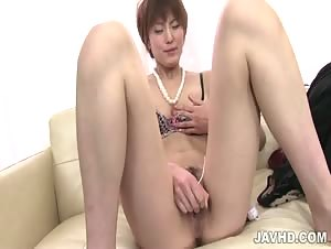 Saori shows off her sextoy skills as she shoves a rabbit up her twat.