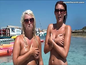 April and Becca topless at the beach