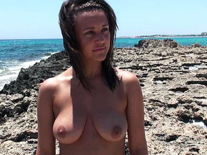 Beautiful brunette topless at the beach