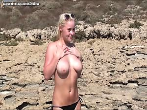 Beautiful girls topless at the beach
