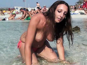 Beautiful brunette girl topless at the beach