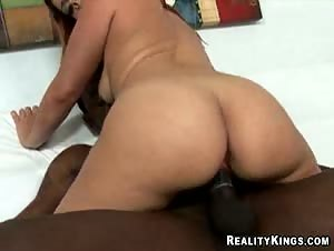 Brie rides that cock as her succulent ass bounces up and down.