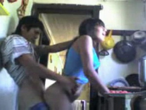 Cute Columbian girl fucked from behind in the kitchen