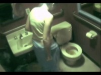 Couple fucking in a public bathroom