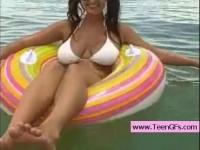 Busty babe flashing tits at sea