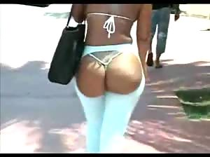 Black babe in minibikini walking the streets