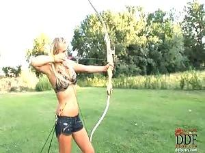 Nikita Valentin with bow and arrow