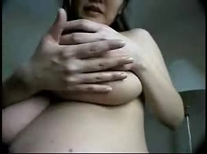 Pregnant Asian chick shows her huge milky tits