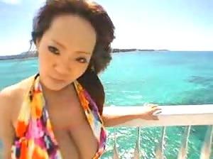 Beautiful Asian babe Hitomi Tanaka naked at the beach